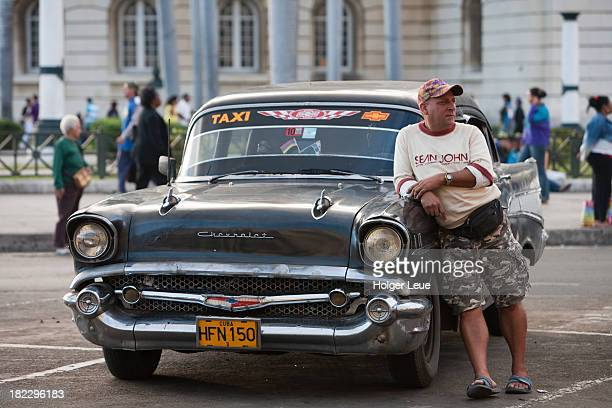 Taxi driver and vintage American taxi