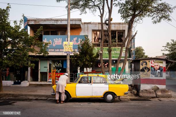 A taxi driver attends to his vehicle in Kabul Afghanistan on Sunday July 15 2018 US President Donald last year said 16000 US troops would remain in...