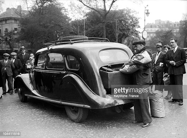 A taxi driver fills up the tank of his car on anthracite