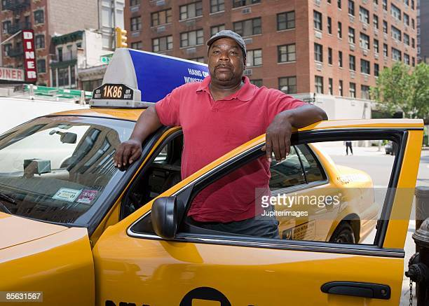 Taxi driver in cab