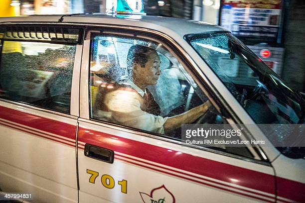 Taxi driver in car in Hakata City, Fukuoka, Japan