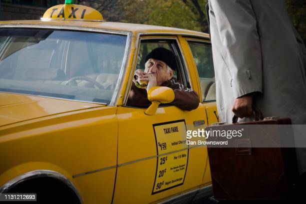 taxi driver interrupted during a break - impossible burger stock pictures, royalty-free photos & images
