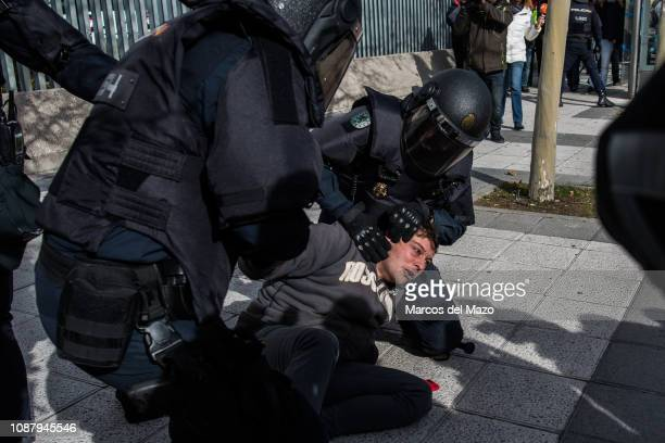 A taxi driver is arrested after a clash with riot police during a protest against transport services such as Uber and Cabify as tourism exhibition...
