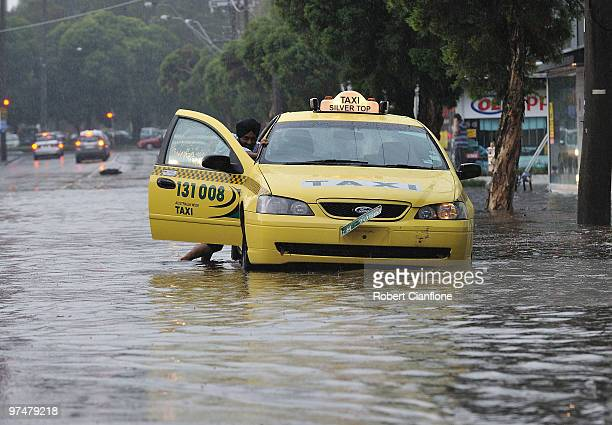 Taxi driver is stranded in a flooded Kensington street after massive storms hit Melbourne city on March 6, 2010 in Melbourne, Australia.