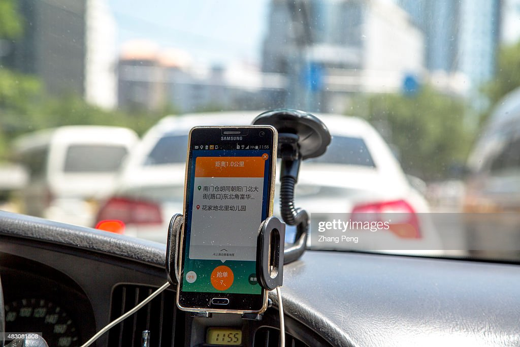 A taxi driver is using Didi Dacha App while driving on the way. China Investment Corporation (CIC) has made an undisclosed investment in Chinese taxi-hailing app maker Didi Kuaidi.