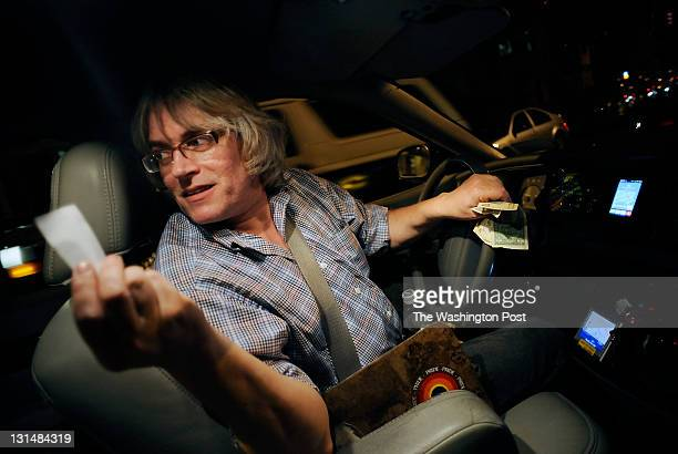 Taxi driver Larry Frankel of Taxi By Larry offers a receipt to a rider while working on Tuesday October 18 2011 in Washington DC Frankel has been a...