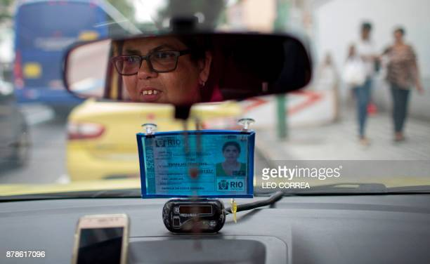 Taxi driver Patricia da Costa Ferreira poses for the picture inside her cab in Rio de Janeiro Brazil on November 24 2017 After twelve years working...