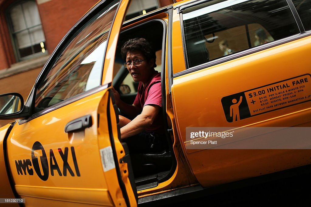 A taxi driver pauses in his vehicle on September 4, 2012 in New York City. As of Tuesday, yellow taxis may begin charging more following an approved fare increase for riders. Taxi rates have remained virtually unchanged since 2006 and will now rise by an expected 17 percent.