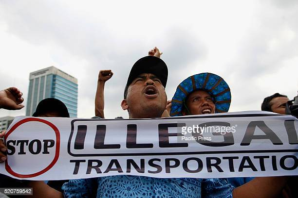A taxi driver shouts slogans in front of the parliament building during a protest rally to demand the government to prohibit ridehailing apps