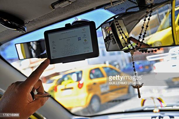 A taxi driver shows an application for smart mobile phones or tablets to order a 'safe taxi' wich in connected via GPS and able to report dangerous...