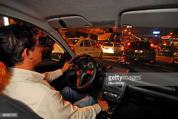 A taxi driver sits in a traffic jam while listening to the radio program 'Voice of Brazil' in Sao Paulo Brazil Monday June 26 2006