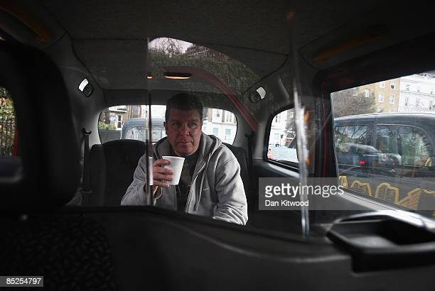 A taxi driver takes a break on March 5 2009 in London England Manganese Bronze the maker of London's black cabs has warned that taxi drivers may be...