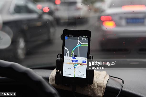 A taxi driver uses a Baidu mapping app on a Xiaomi mobile phone to navigate in traffic in Beijing on August 3 2015 Two Chinese smartphone makers...
