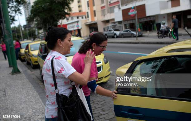 Taxi driver Vanessa Moura attends a client in Rio de Janeiro Brazil on November 24 2017 Moura is part of a group of female taxi drivers that work...