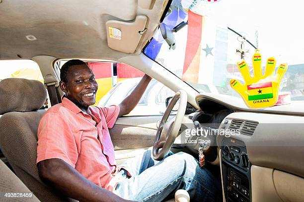 taxi driver with his taxi in west africa - ghana africa fotografías e imágenes de stock