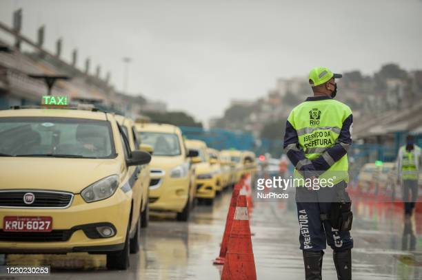 taxi drivers are seen waiting to take the COVID19 test during an action carried out by the city hall of Rio de Janeiro at the Marquis de Sapucaí...