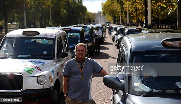 Taxi drivers block The Mall road during in a mass slowdriving demonstration in city of Westminster London England on September 24 2014 They protest...
