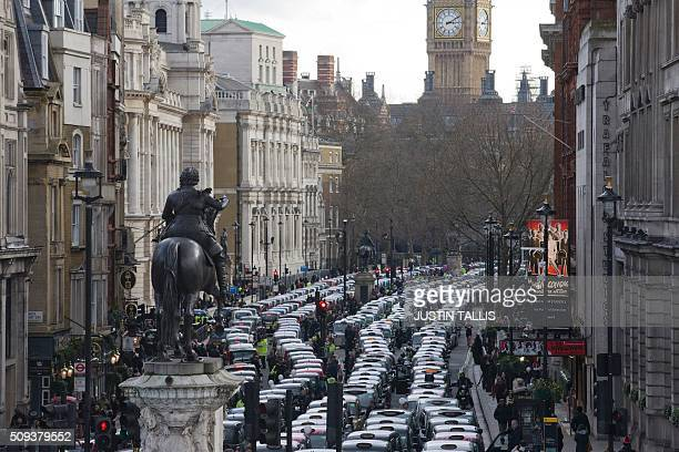 TOPSHOT Taxi drivers block Whitehall as they demonstrate in central London on February 10 2016 Up to 5000 taxi drivers protested in central London...