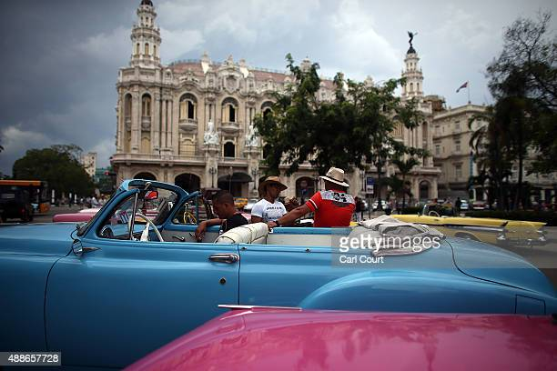 Taxi drivers chat around their vintage American cars on September 16 2015 in Havana Cuba Pope Francis is due to make a three day visit to Cuba from...