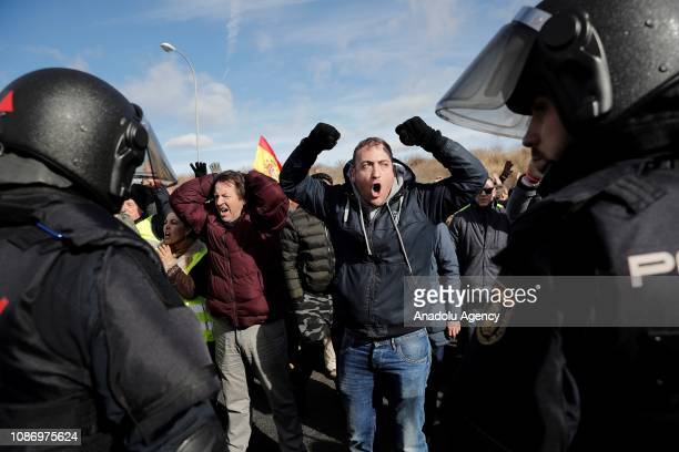 Taxi drivers clash with policemen after blocking the M40 highway as they protest against regulations proposed by the authorities for the VTC licenses...