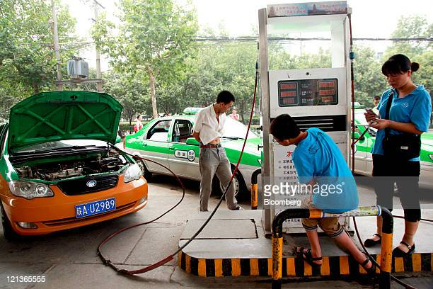Taxi drivers fill up their cars at a China Natural Gas Inc filling station in Xi'an Shaanxi Province China on Thursday Aug 11 2011 China Natural Gas...