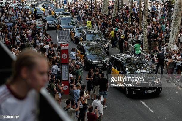 Taxi drivers gather at La Rambla boulevard to protest against terror, during a memorial for the victims those who lost their lives in terror attack...