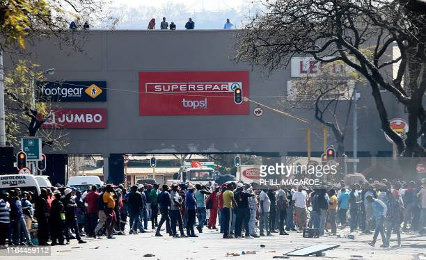 Taxi drivers participate in a riot near the Bloed Taxi Rank on August 28 in Pretoria Central Business District South Africa The drivers are...
