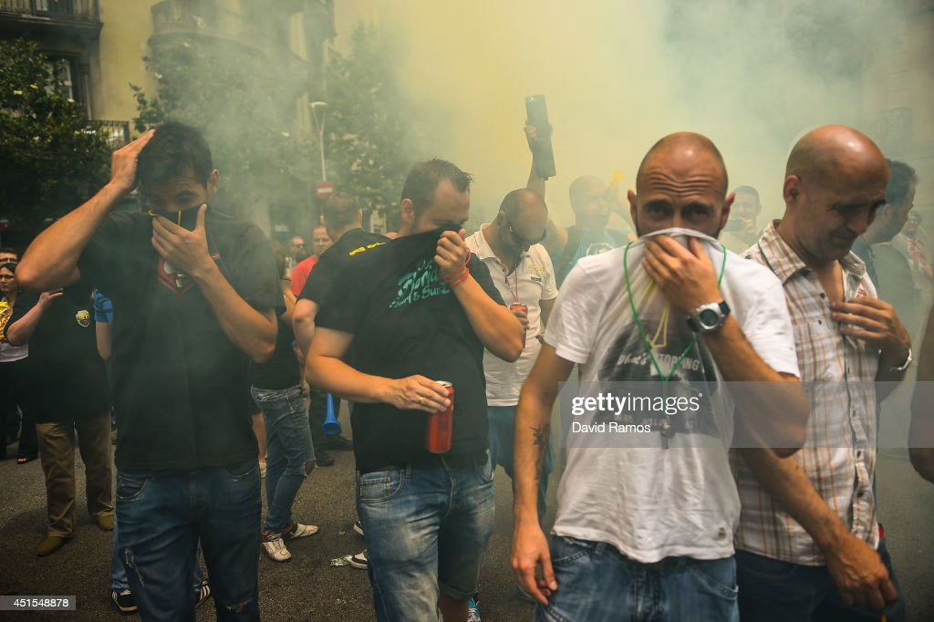 Taxi drivers protest against a new smart phones app 'Uber' during a 24 hours strike on July 1, 2014 in Barcelona, Spain. Taxi drivers in main cities strike over unlicensed car-hailing services. Drivers say that is a lack of regulation behind the new app.