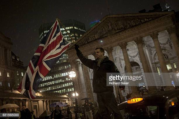 A Taxi drivers' protest gridlocks Bank junction in London's financial district with their black cabs forcing cyclists and pedestrians to weave around...
