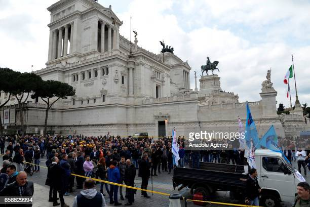 Taxi drivers protest in Rome in response to an amendment that drivers say will favor smartphone app-based car transport company Uber and unfair...