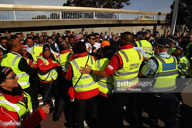 Taxi drivers security guards and police clash during a protest at Melbourne Airport on May 3 2013 in Melbourne Australia Taxi drivers in Melbourne...