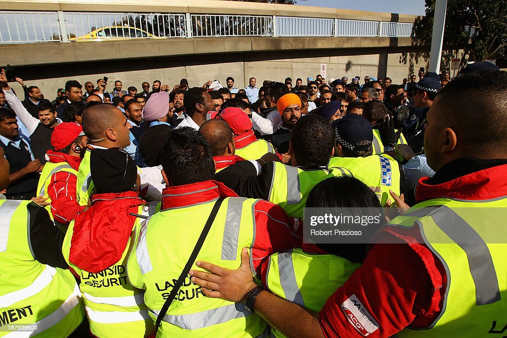 Taxi drivers, security guards and police clash during a protest at Melbourne Airport on May 3, 2013 in Melbourne, Australia. Taxi drivers in Melbourne are protesting the axing of a 'short-fare queue' which allowed drivers to avoid the holding bay at Melbourne Airport. Australian Federal Police have advised they will act if the drivers proceed with their blockade.