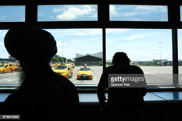 Notices for taxi drivers are written on a wall at a taxi waiting area at John F Kennedy Airport on June 19 2018 in New York City Following the...