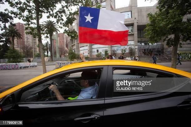 Taxi drivers take part in a protest demanding the resignation of Chile's Minister of Transport and Telecommunications Gloria Hutt in Santiago on...