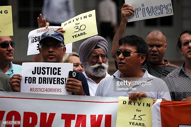 Taxi drivers union members and civic groups hold a news conference and rally on the steps of City Hall to support a City Council move to limit the...