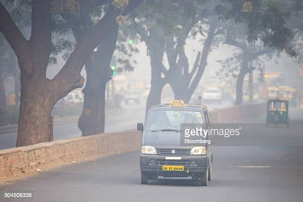 A taxi drives along a road shrouded in smog in New Delhi India on Monday Jan 11 2016 A 2judge Delhi High Court panel headed by Chief Justice G Rohini...