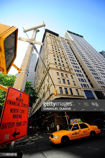 A taxi drives by the building where former IMF head Dominique StraussKahn is being held under house arrest after posting bail in New York May 21 2011...