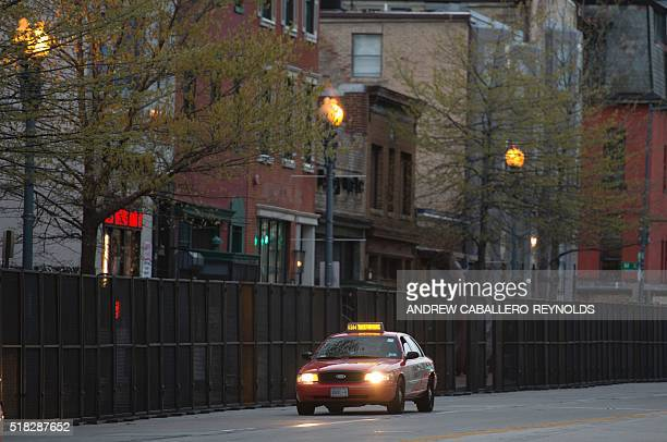 A taxi drives fences setup ahead of the nuclear security summit on March 30 2016 in Washington DC US President Barack Obama hosts several world...