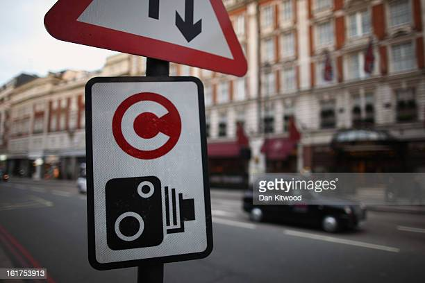 A taxi drives past a congestion charge sign near Victoria on February 15 2013 in London England The weekday charge was introduced by the then Mayor...