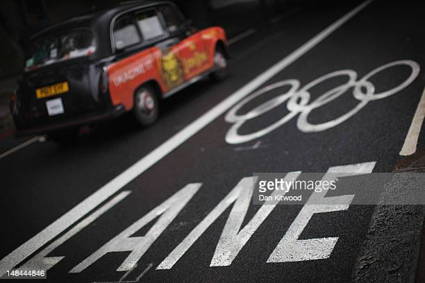 A taxi drives past an Olympic Lane marking on the Embankment on July 16 2012 in London England The first Olympic lanes were due to be closed to all...