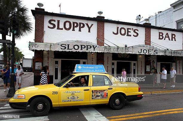 Taxi drives past Sloppy Joe's Bar on Duval Street on September 12, 2013 in Key West, Florida. The city recently enacted a Key West City Ordinance...