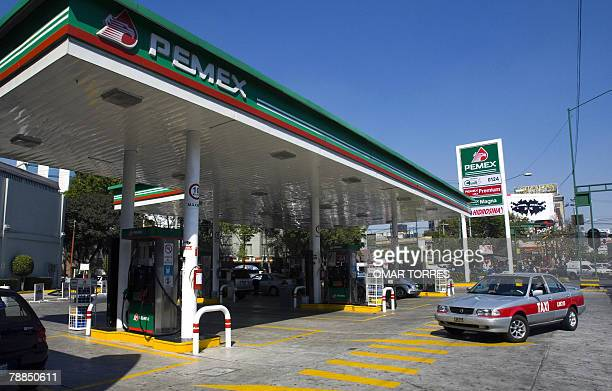 A taxi enters a Pemex gasoline station in Mexico City 09 January 2008 The increase in the prices of basic products along with the controversy for the...