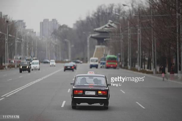A taxi goes on the street on April 2 2011 in Pyongyang North Korea Pyongyang is the capital city of North Korea and the population is about 2000