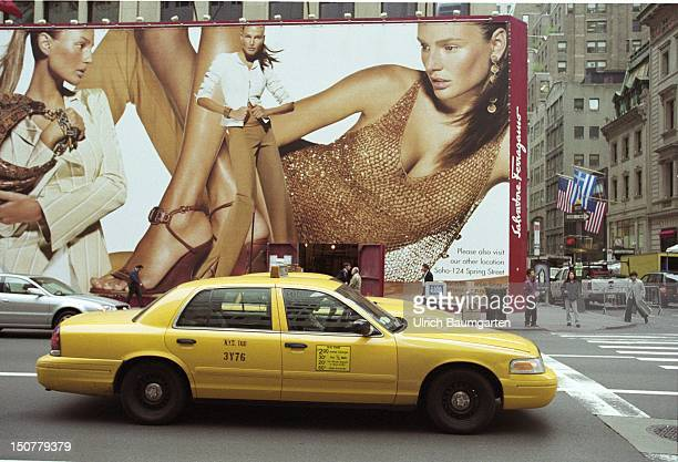 Taxi in front of a big billboard on the 5th avenue