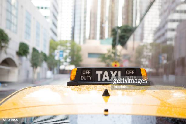Taxi in the Rain in City