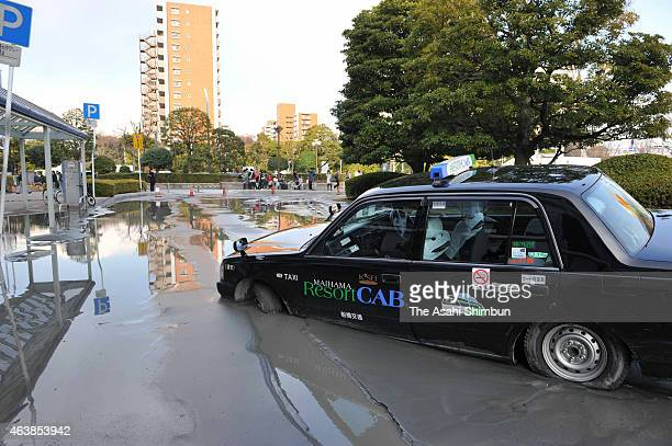 A taxi is buried in the mud as liquefaction occured after the magnitude 90 strong earthquake on March 11 2011 in Urayasu Chiba Japan The reclaimed...