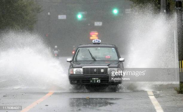 Taxi is pictured in Ise, Mie Prefecture, central Japan, on Oct. 12 ahead of the arrival of Typhoon Hagibis, which is expected to make landfall in...