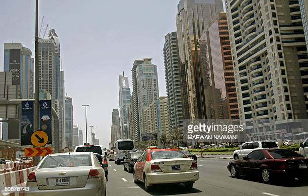 A taxi is seen in traffic along Sheikh Zayed road in Dubai April 272008 AFP PHOTO/MARWAN NAAMANI