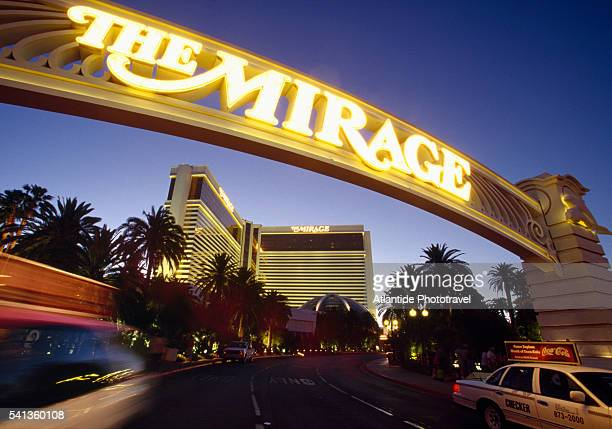 taxi leaving the mirage in las vegas - mirage hotel stock pictures, royalty-free photos & images