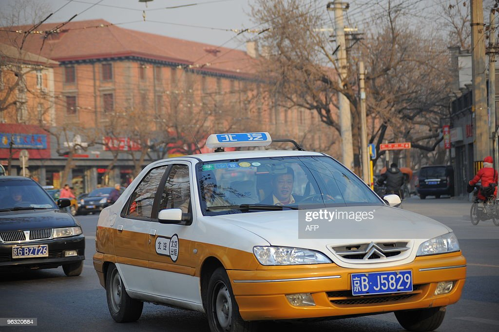 A taxi makes its way along a street in B : News Photo